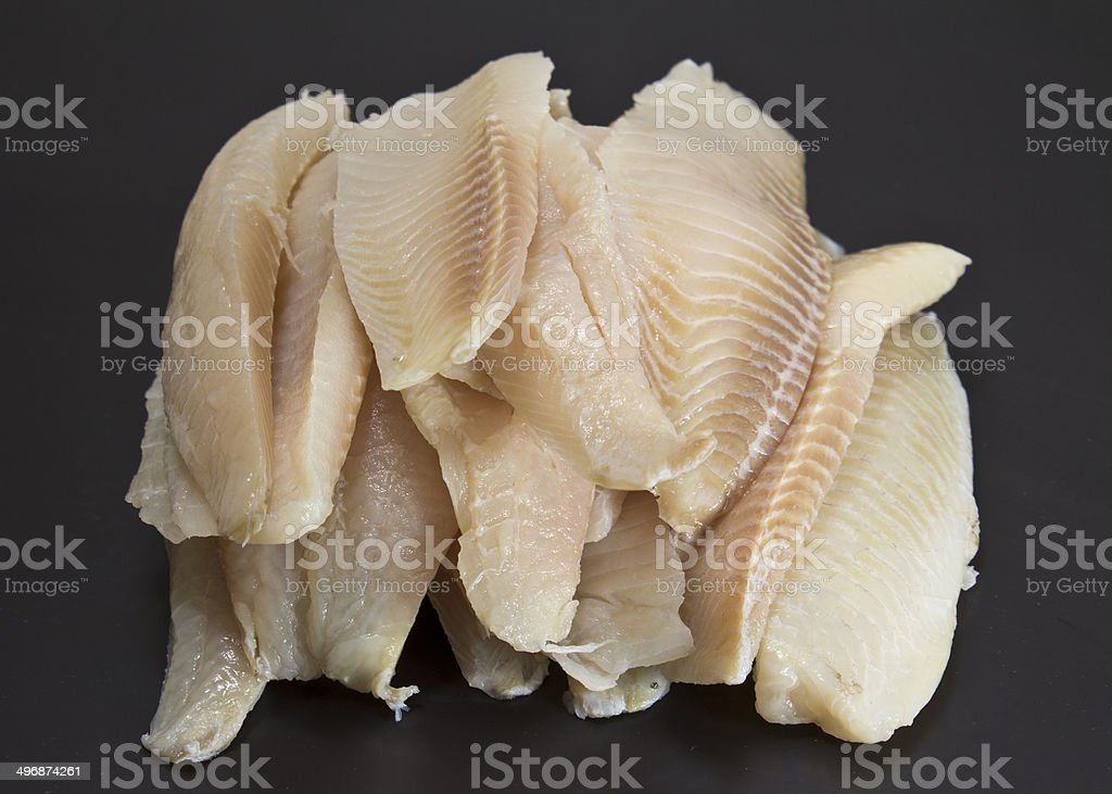 perch fillet over black background stock photo