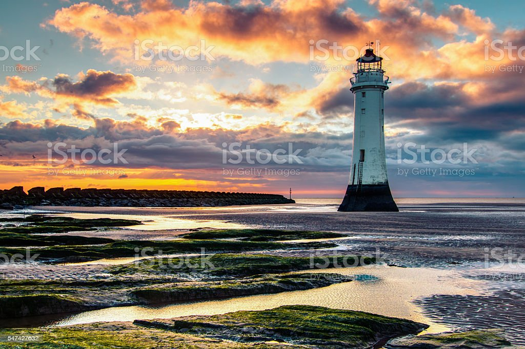 Perch Rock Lighthouse and beach at sunset stock photo
