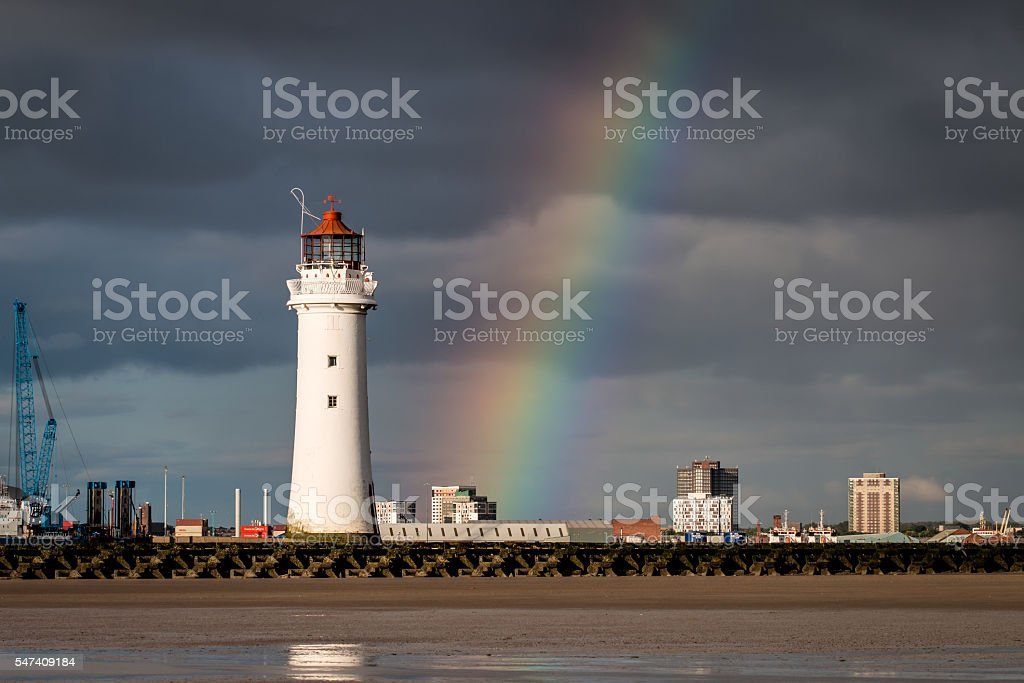 Perch Rock Lighthouse and rainbow stock photo