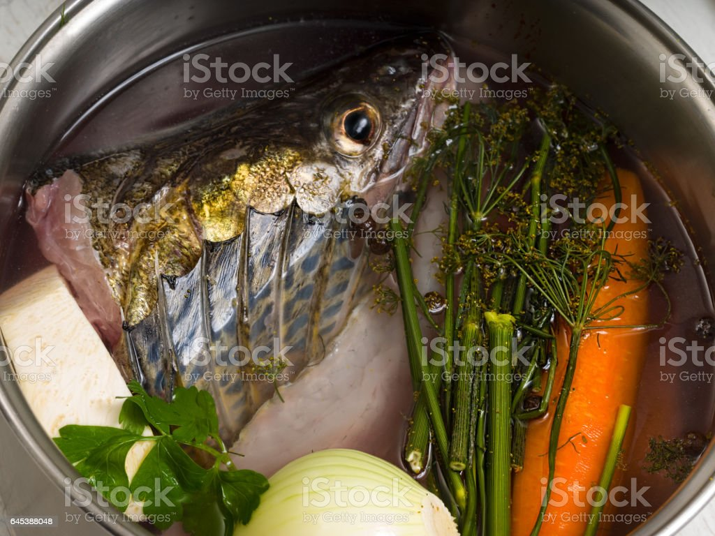 Perch stock in a steel pot stock photo