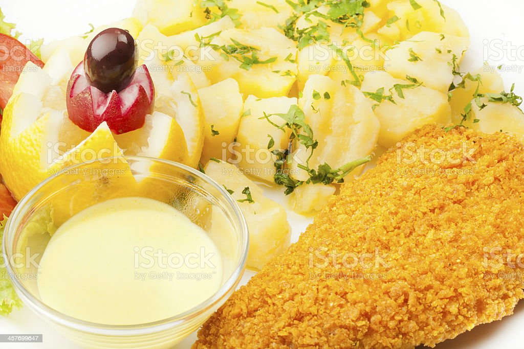 Perch whit corn flakes poatato sauce and lemon royalty-free stock photo