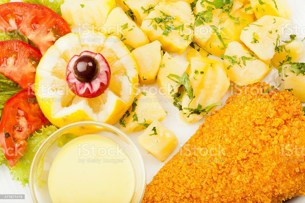 Perch whit corn flakes poatato sauce and lemon stock photo