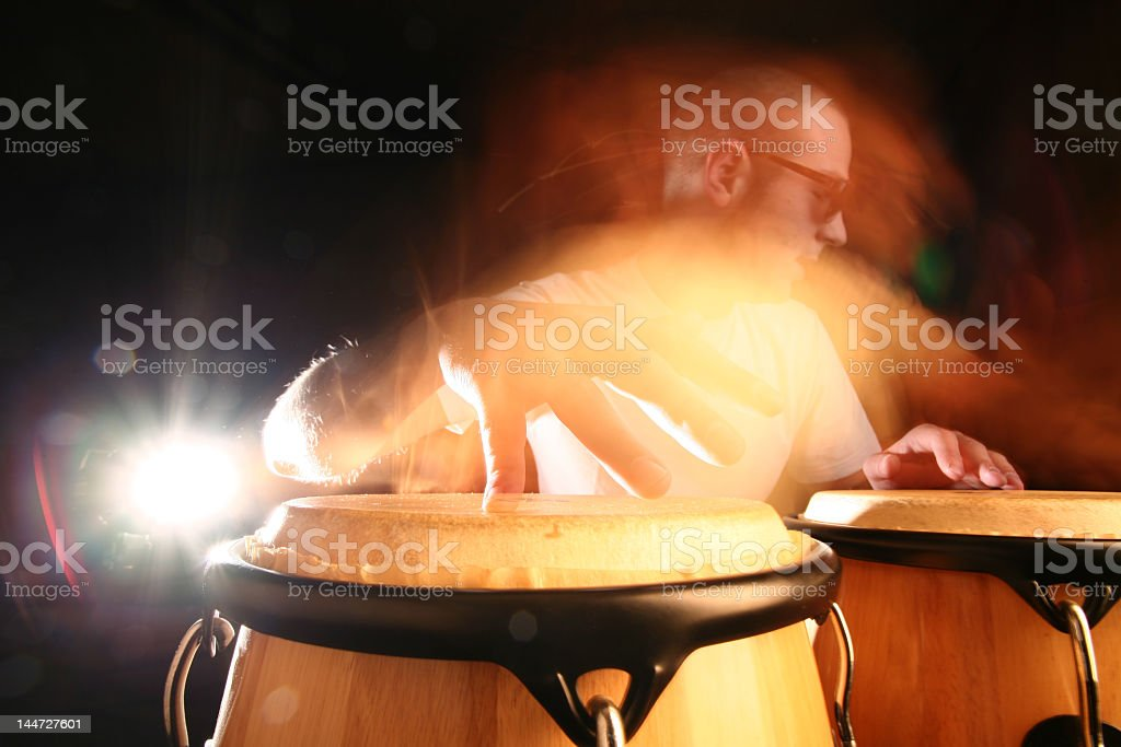 Percussionist playing bongos in action photo stock photo