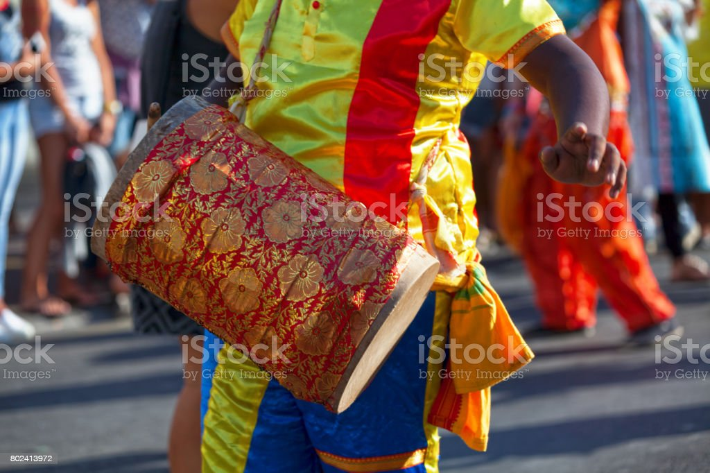 Percussionist playing with a dhol stock photo