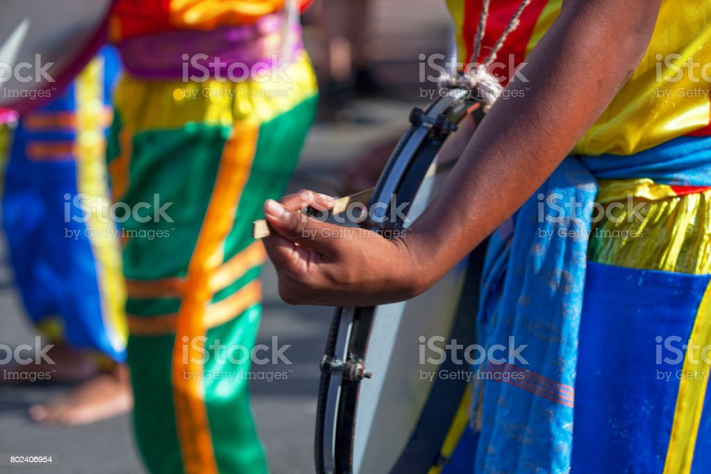 Percussionist playing with a frame drum stock photo