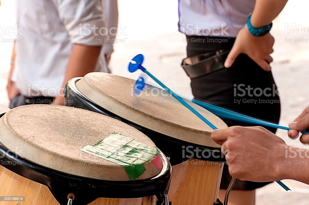 Percussionist slap hand on the Conga in school. stock photo