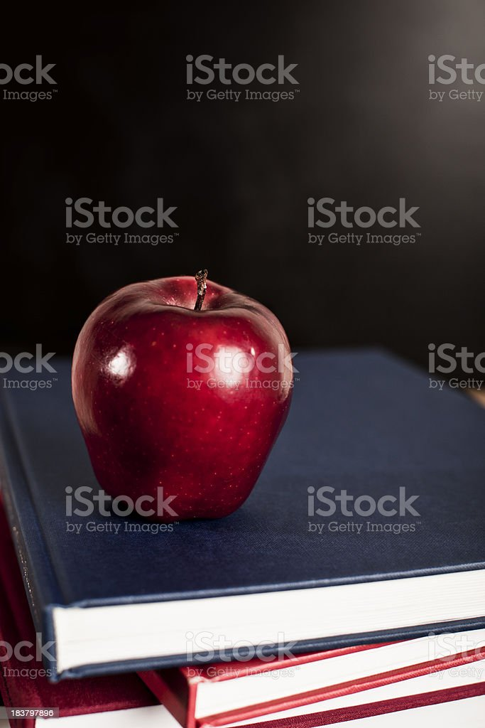 perfect apple on top of books royalty-free stock photo