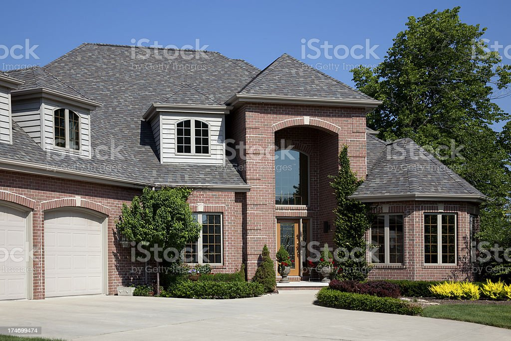 Perfect Brick, Cedar Home Exterior Archicectural Design, Clean Green Landscaping royalty-free stock photo