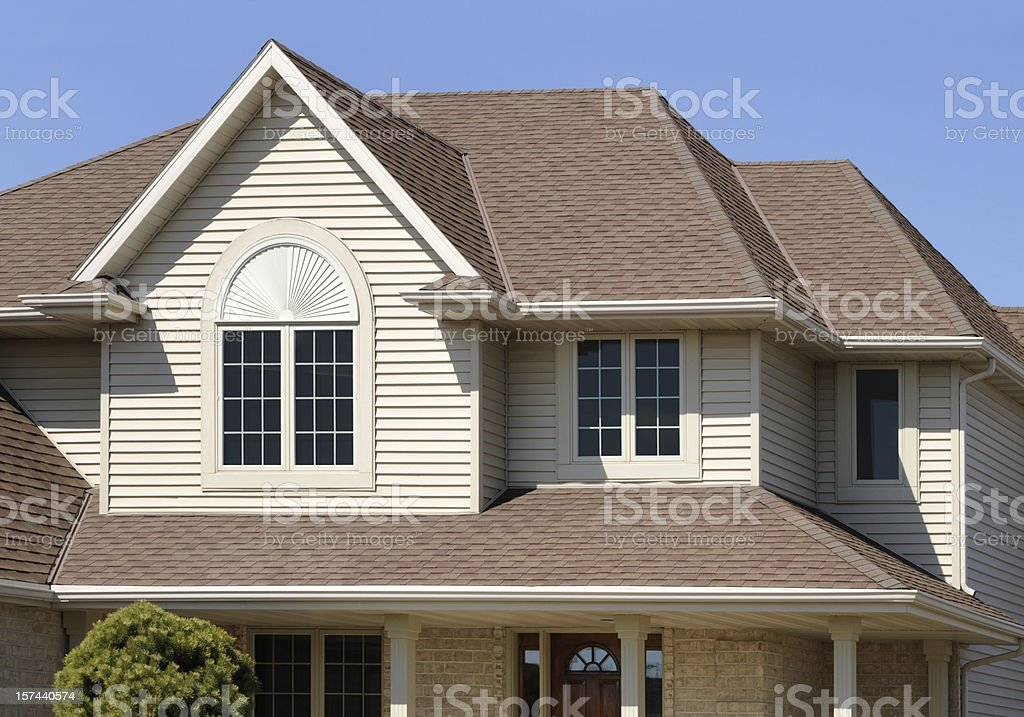 Perfect Brown Home With Gabled Architectural Asphalt Roof, Vinyl Siding royalty-free stock photo