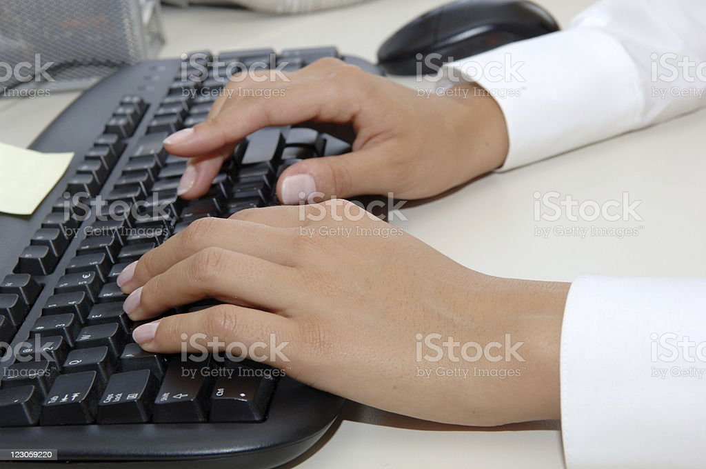 Perfect businesswoman typing stock photo