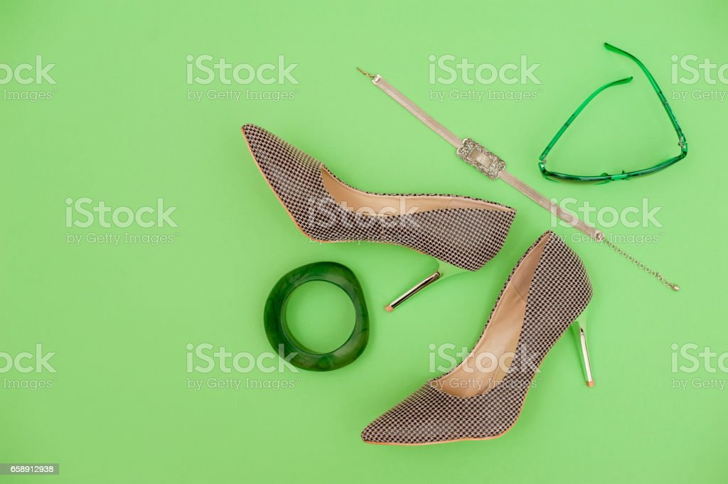 Perfect Combination Of Green And Brown Personal Accessory On Green...