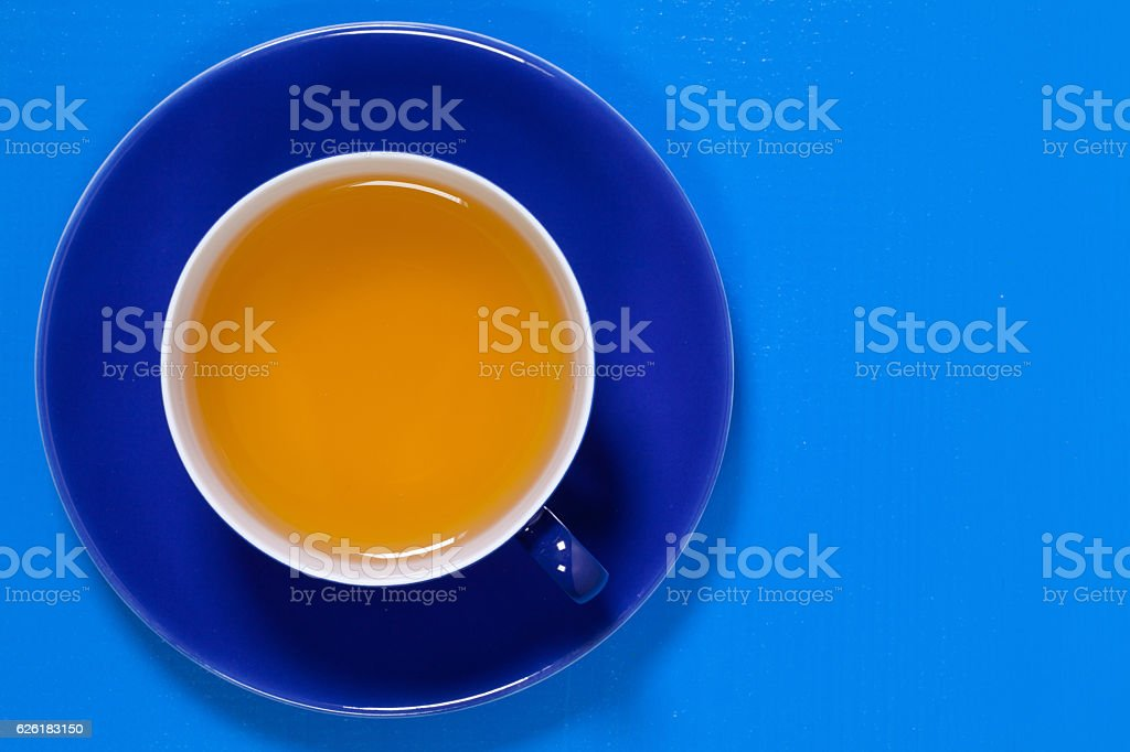 Perfect cup of tea on blue wooden table stock photo