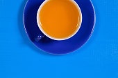 Perfect cup of tea on blue wooden table