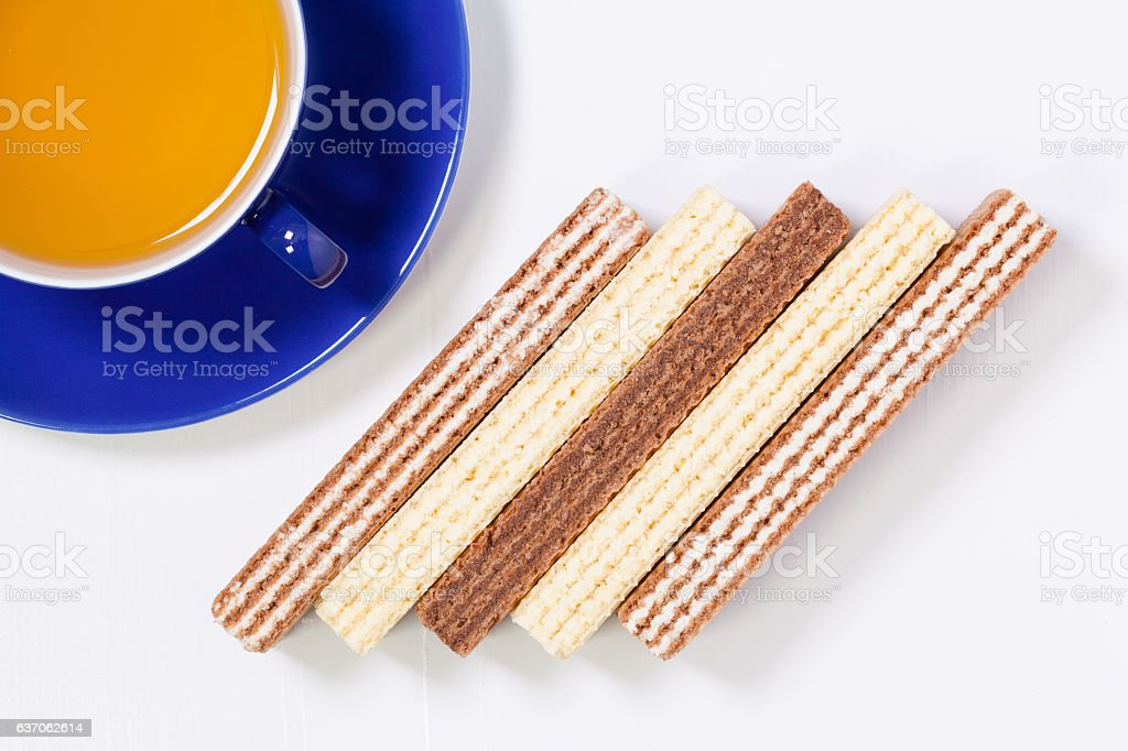 Perfect cup of tea on wooden table with sweet wafers stock photo