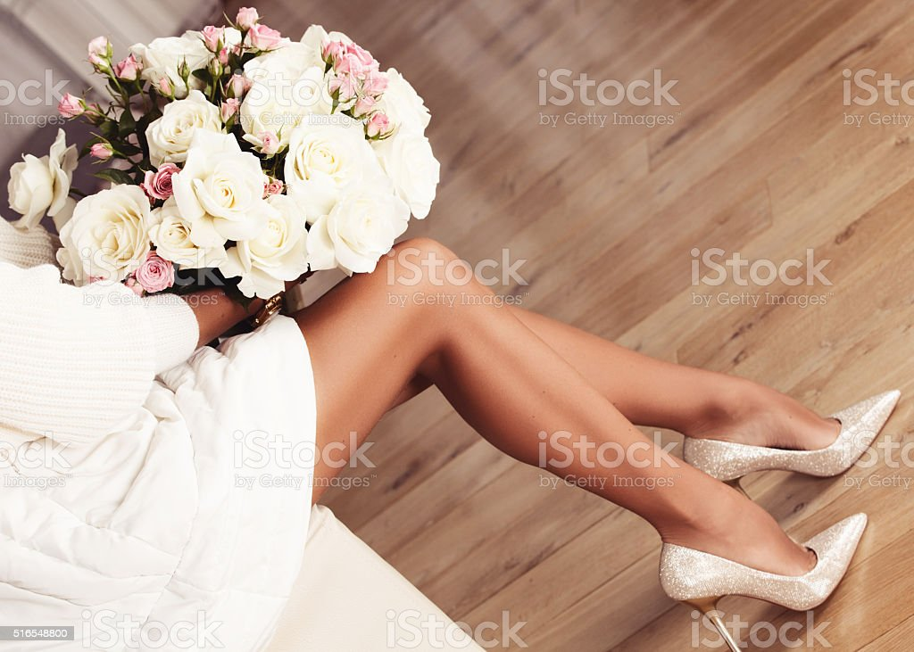 Perfect female legs wearing high heels. stock photo