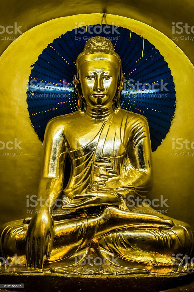 perfect golden Buddha with blue halo and decent vignette stock photo