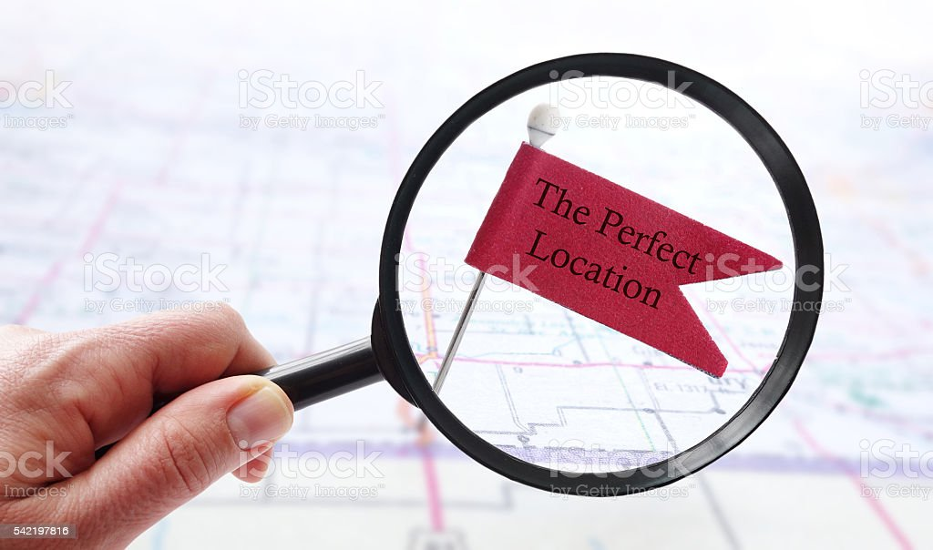 Perfect Location pin flag stock photo