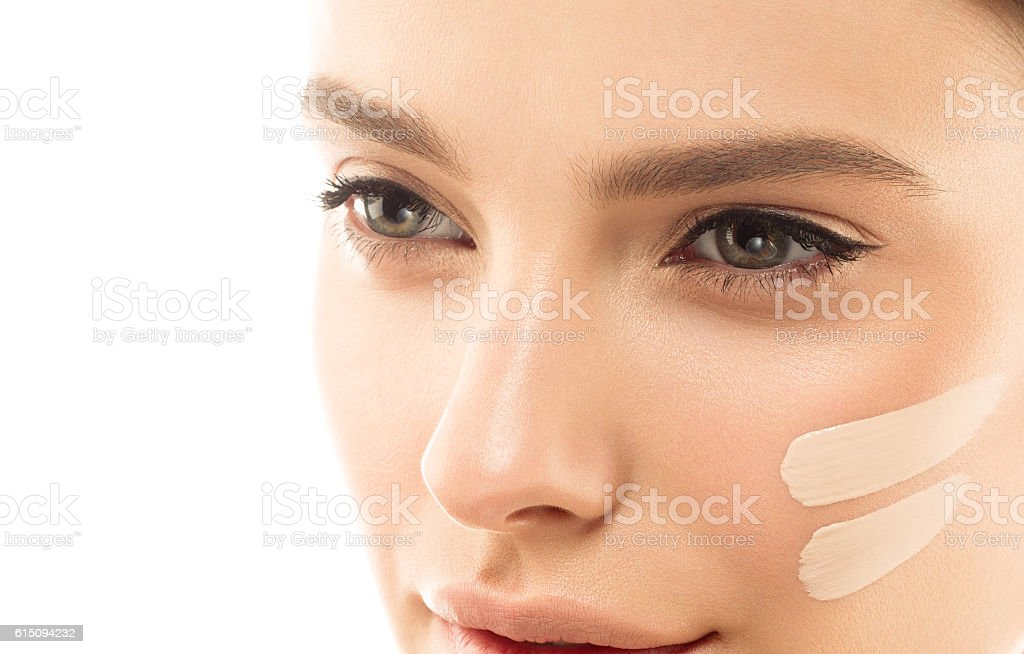 Perfect makeup. Skin tone cream lines on woman face. stock photo