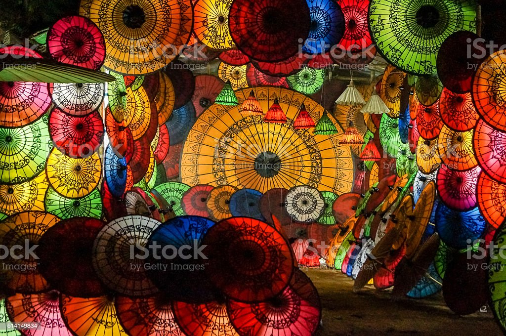 perfect multicolored umbrella parasol collage burmesian style at night stock photo