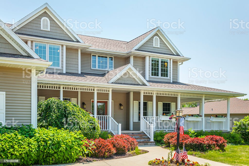 Perfect, Ornate Maintenance Free Home With Covered Porch stock photo