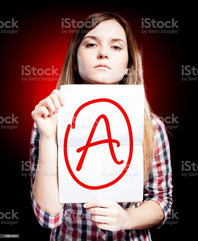 Perfect school grade A of exam and proud girl royalty-free stock photo