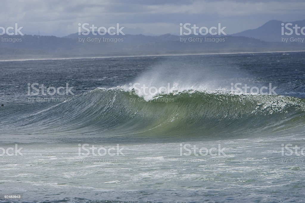 Perfect wave rolls in royalty-free stock photo