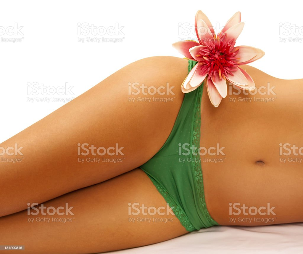 Perfect woman's body with cute flower on her hip , stock photo