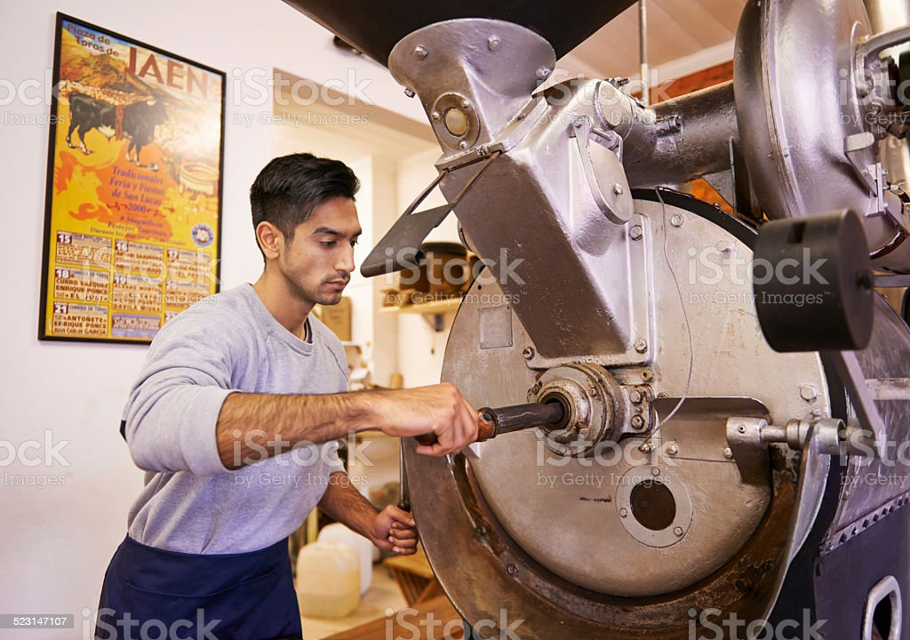 Perfecting his roasting process stock photo