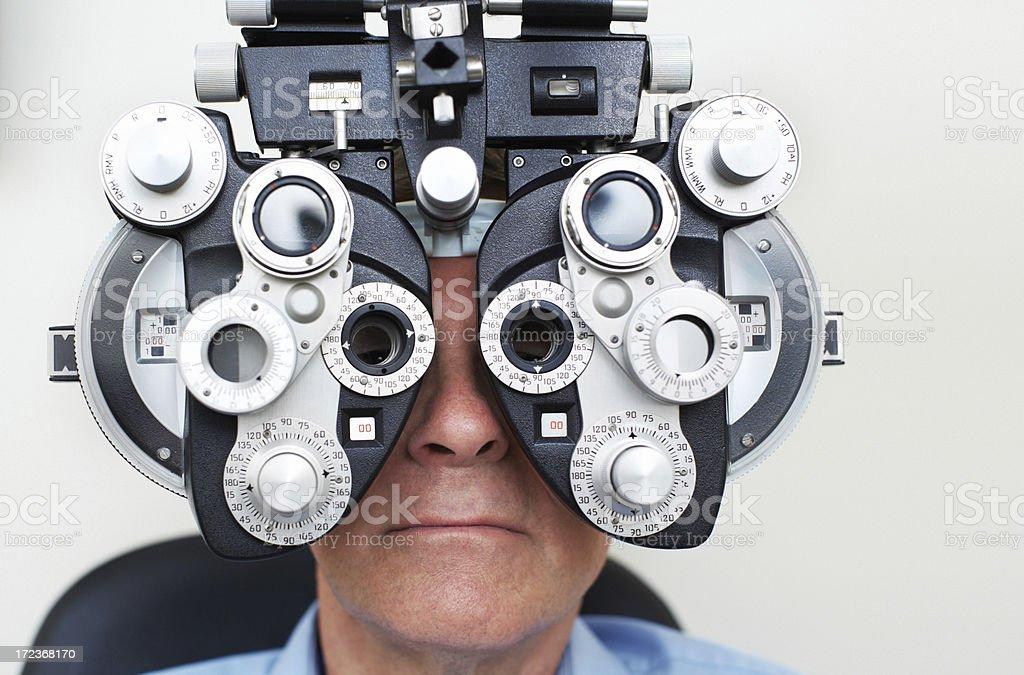 Perfecting his vision stock photo