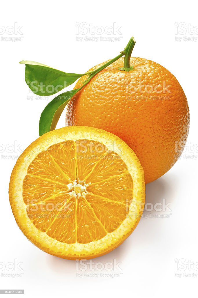 Perfectly cut orange and an a whole orange with stem royalty-free stock photo