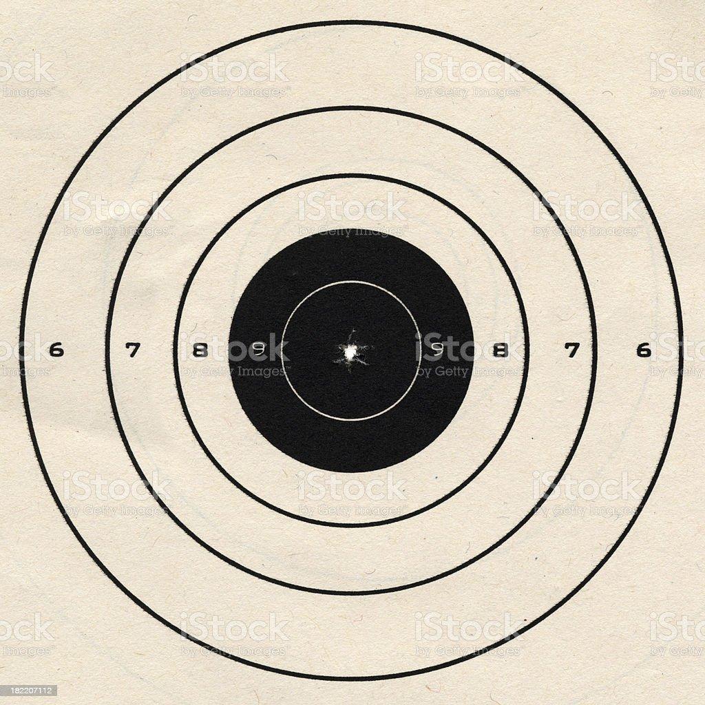 Perfectly Shot Bullseye in Paper Target stock photo
