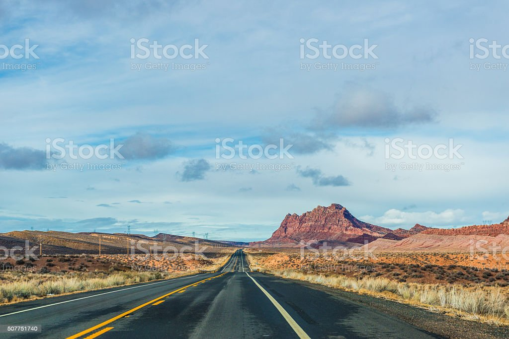 Perfectly smooth America highway across the endless desert stock photo