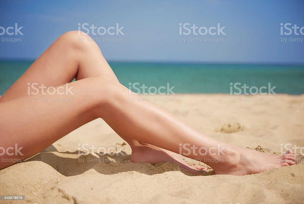 Perfectly tanned slim human legs stock photo