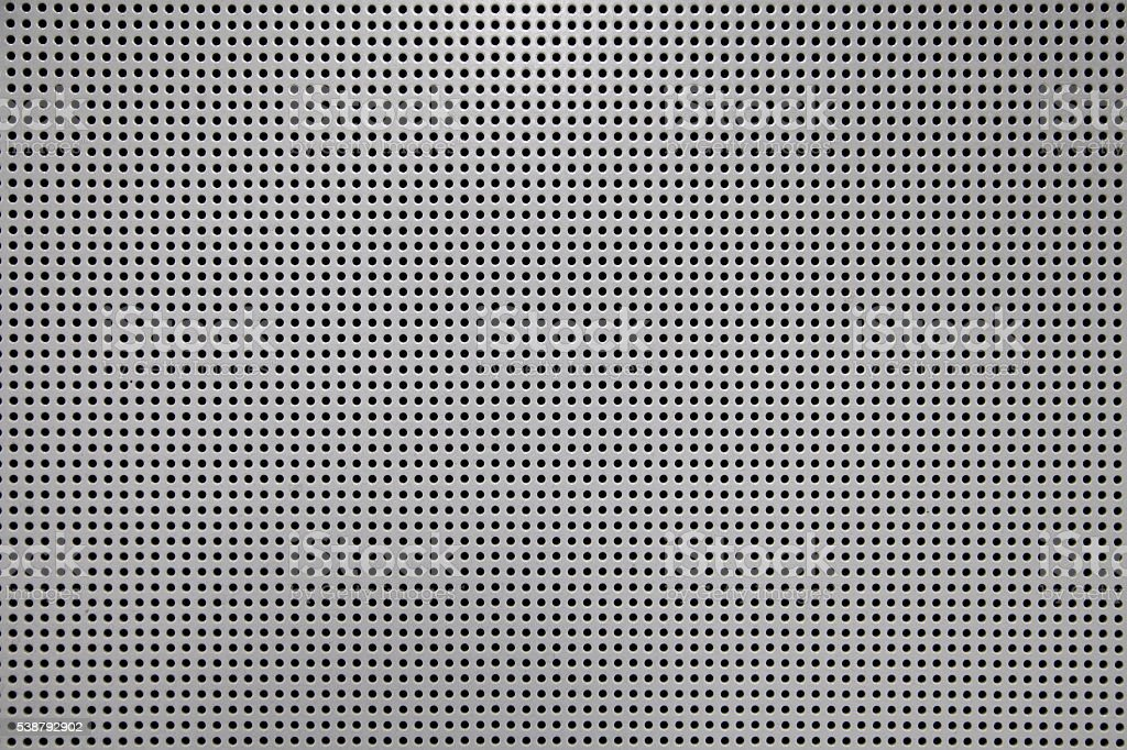 Perforated acoustic wall  macro shot stock photo