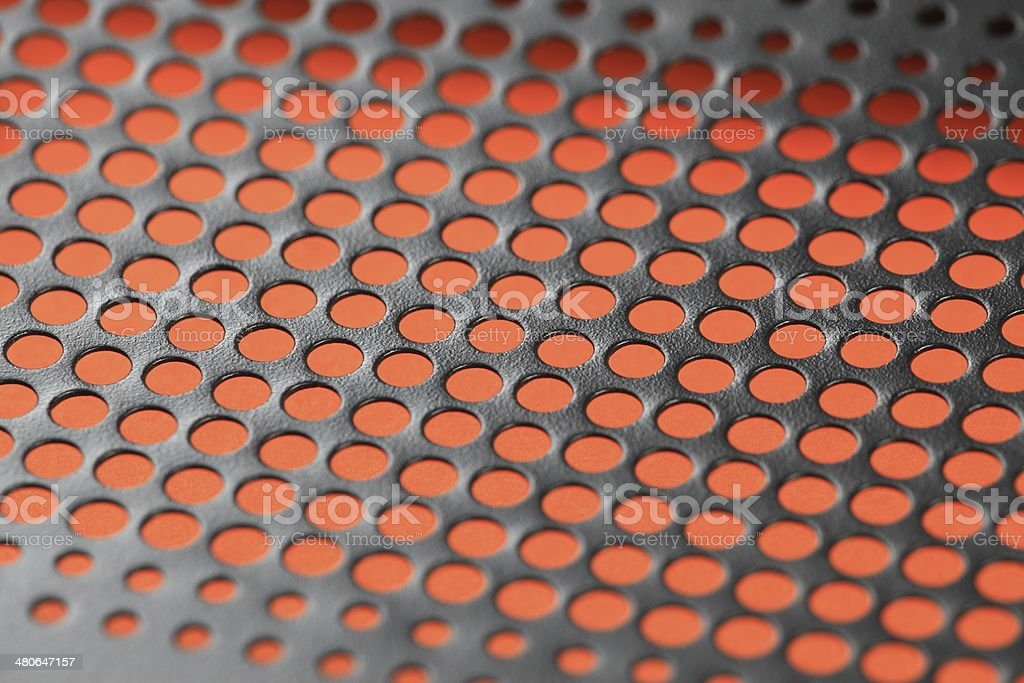 perforated metal background stock photo