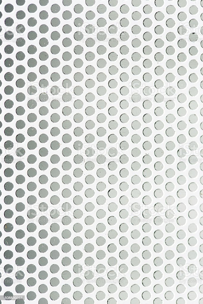 Perforated metal grid texture stock photo