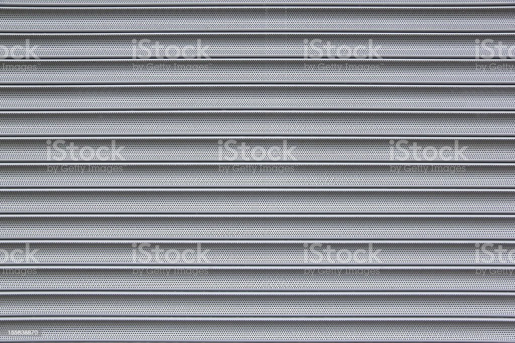 perforated metal security shutter background royalty-free stock photo