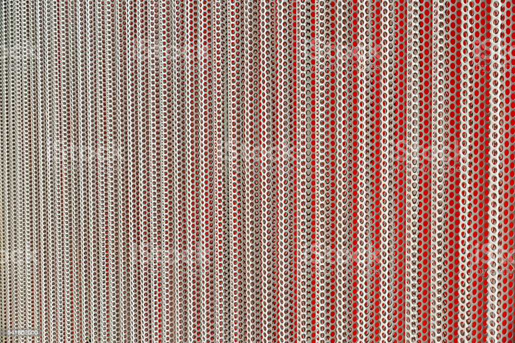 Perforated metal surface stock photo