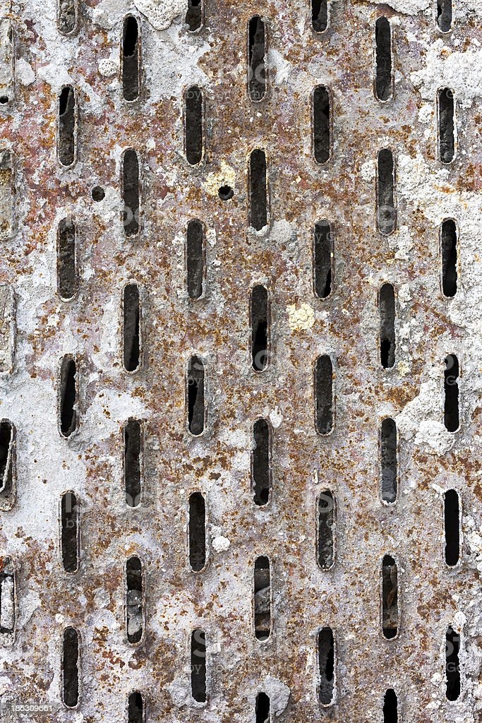 Perforated rusty metal royalty-free stock photo