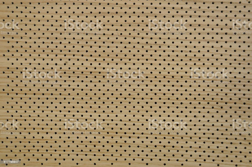 perforated wooden surface background stock photo