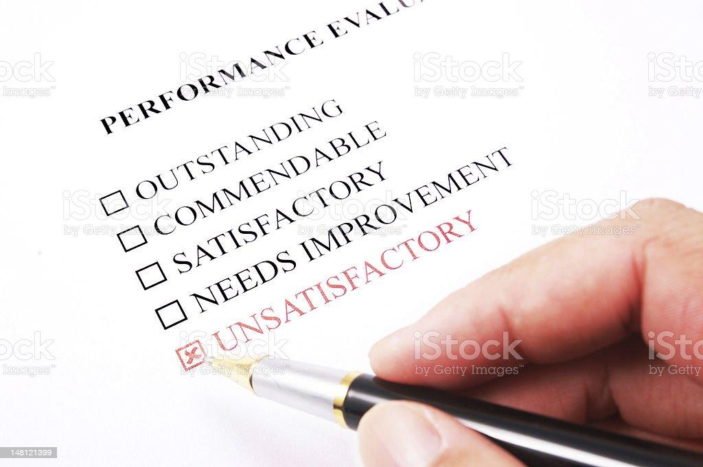 performance evaluation form - unsatisfactory stock photo