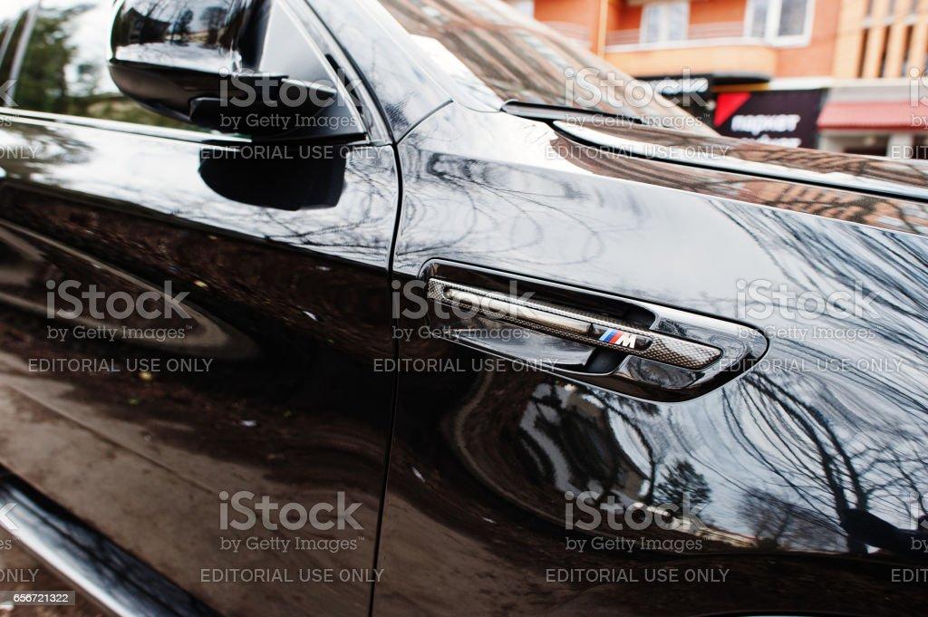 Kiev, Ukraine - March 22, 2017: BMW X6 M performance label. stock photo