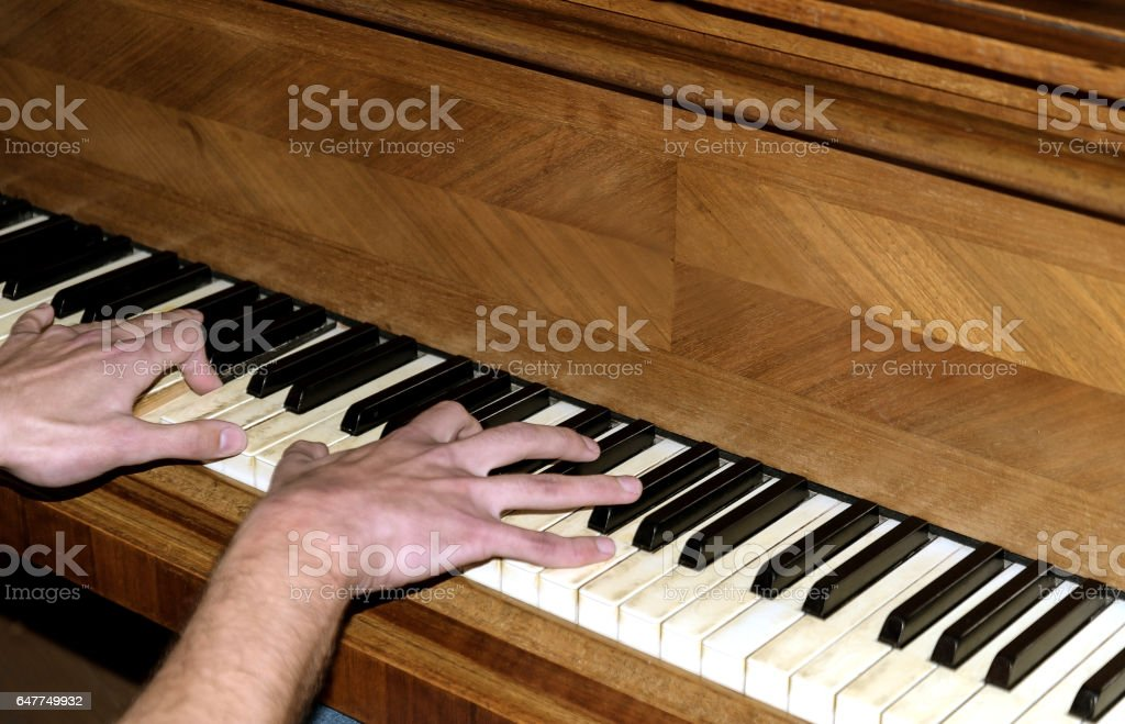 performance on piano focus for men hands stock photo