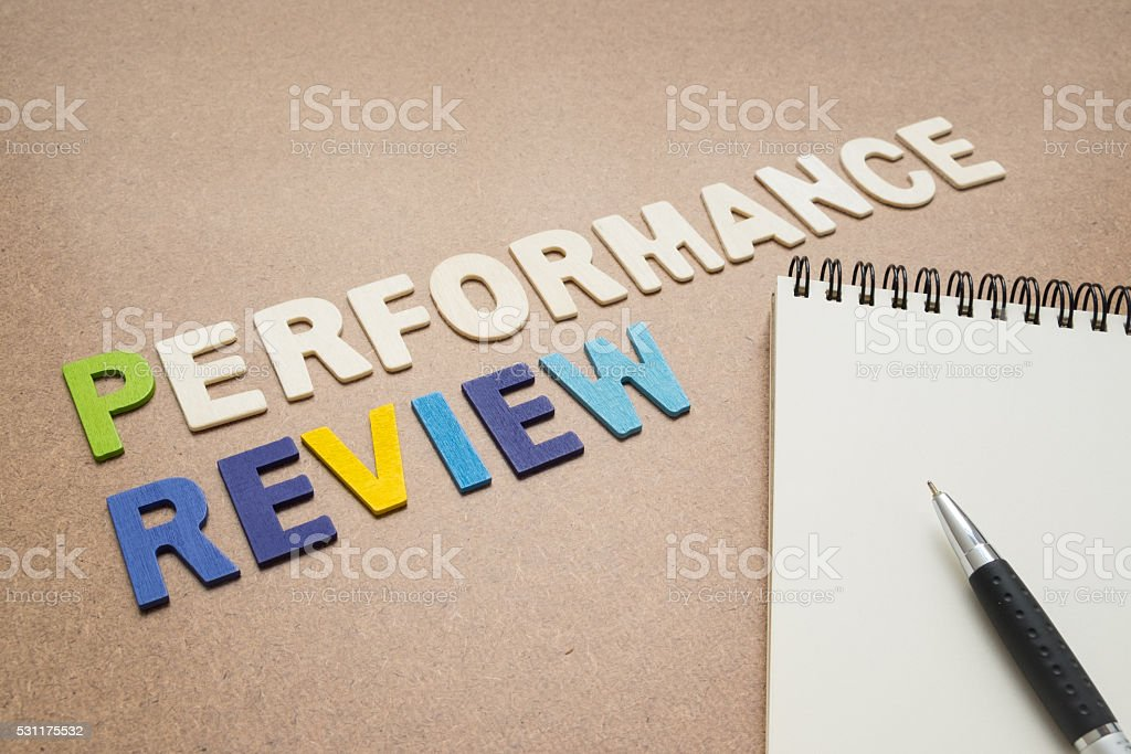 Performance review text with open spiral notebook and pen stock photo