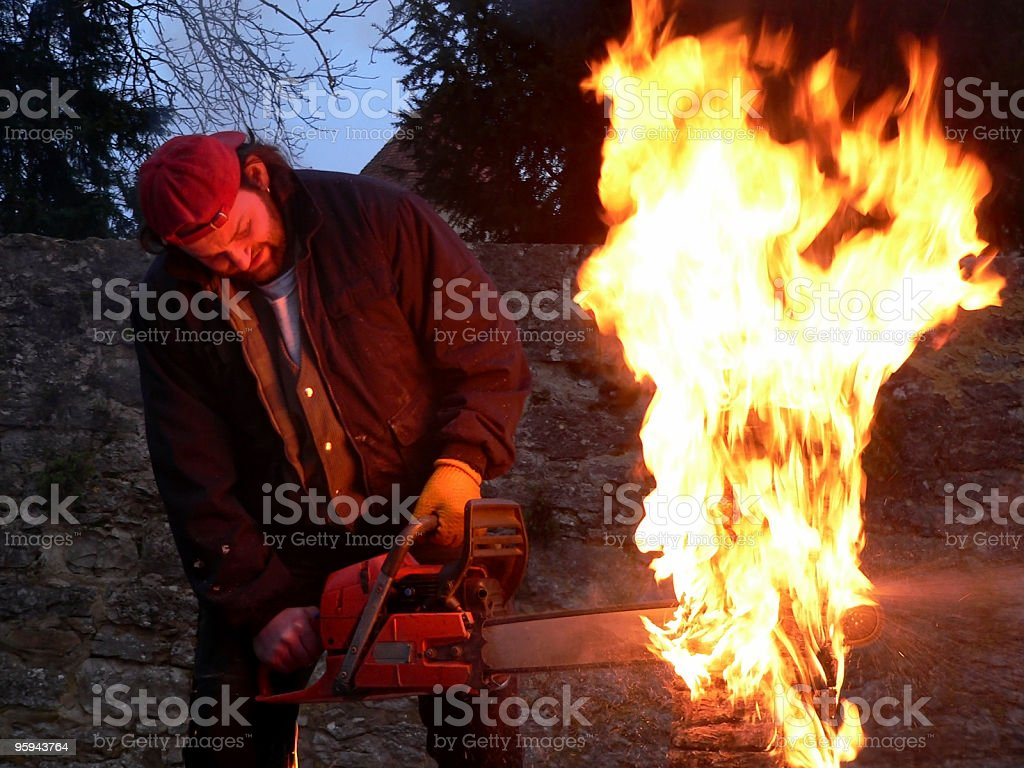 performance with chainsaw royalty-free stock photo