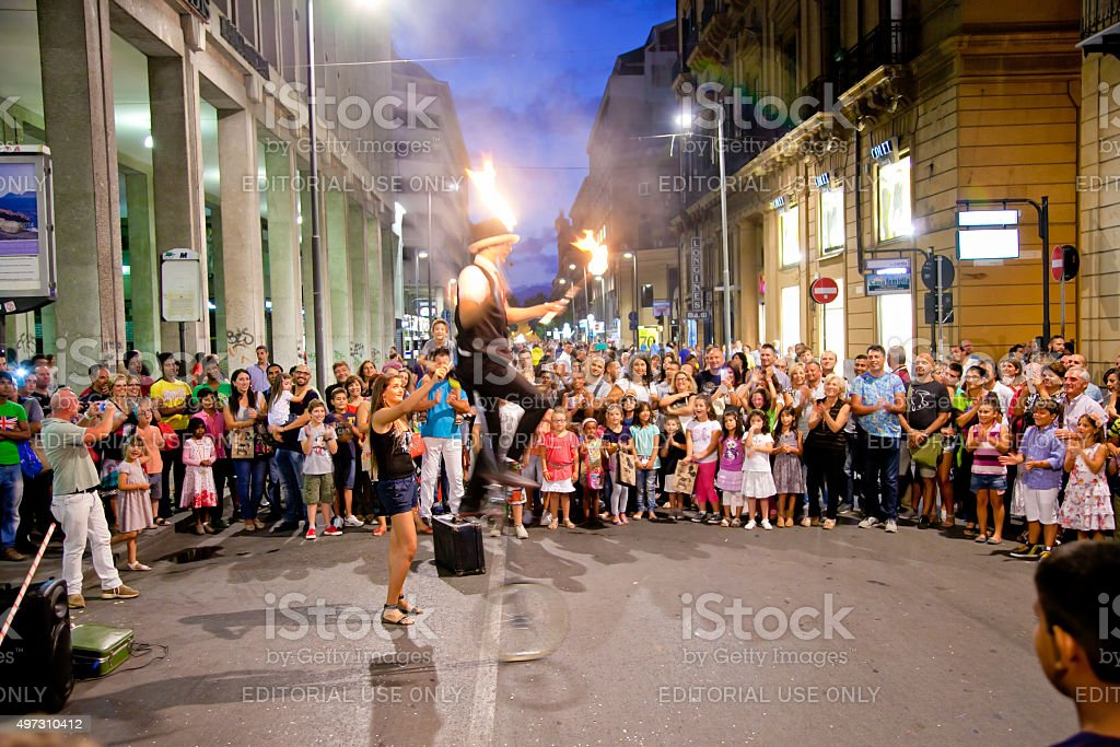 Performer balances on a unicycle in Palermo, Italy. stock photo