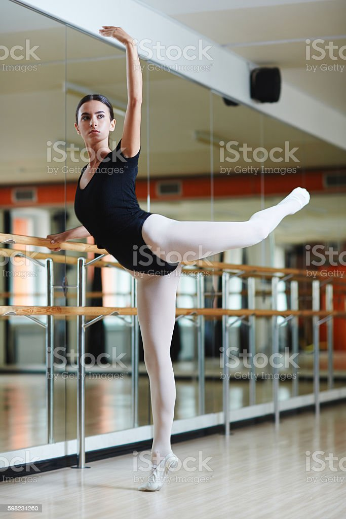 Young performer having choreographical repetition