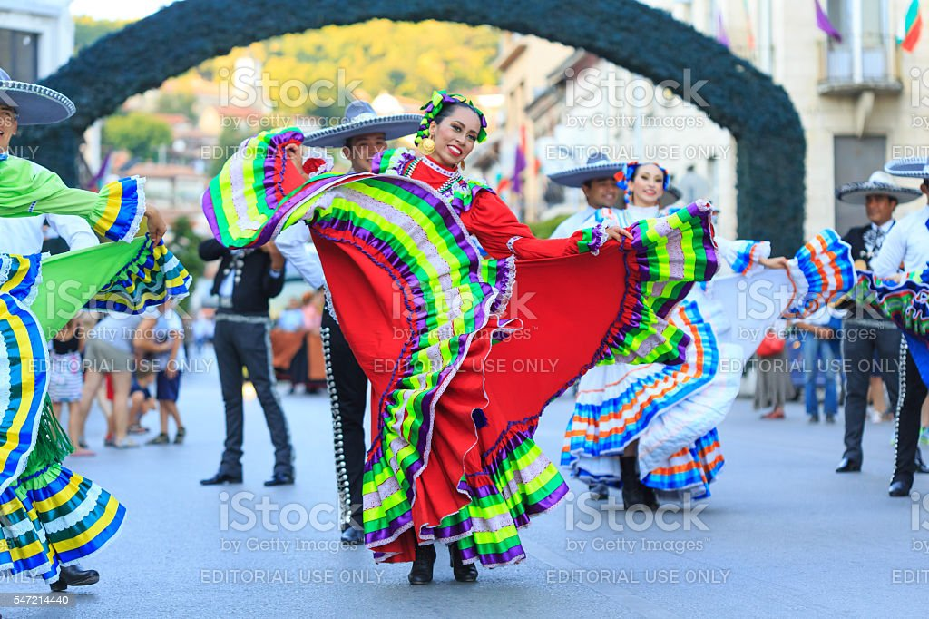 Performers from Mexican group dancing on street in traditional costumes stock photo