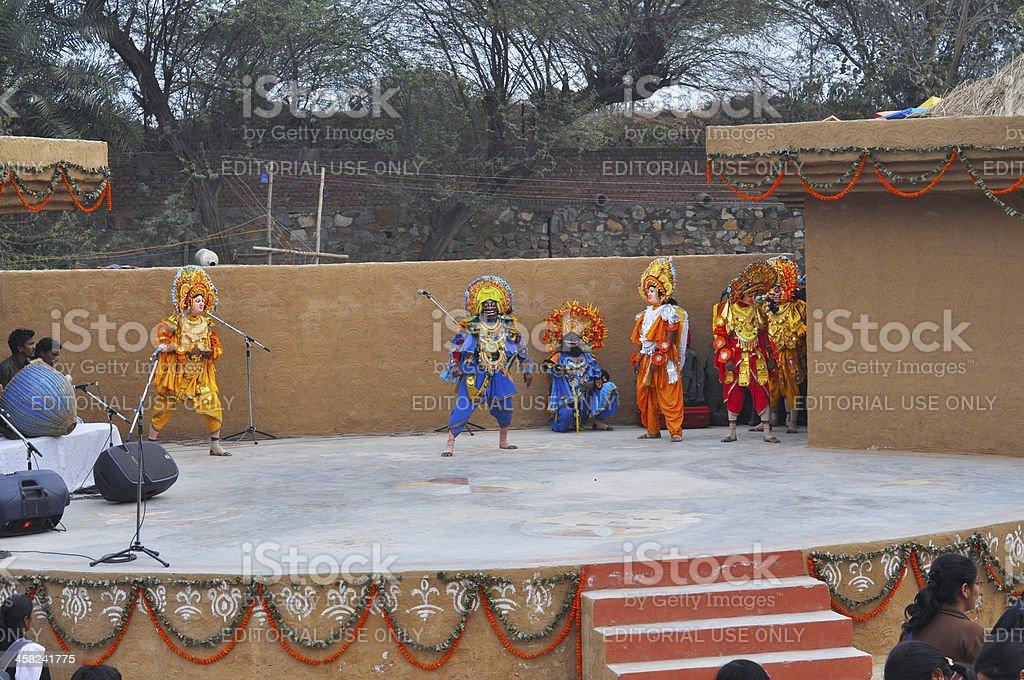 Performers performing Chhau dance during Surajkund mela royalty-free stock photo