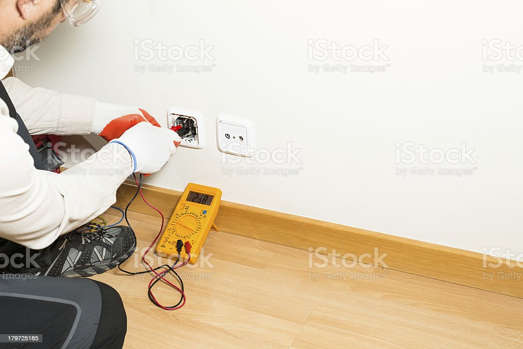 Performing a repair electrician stock photo